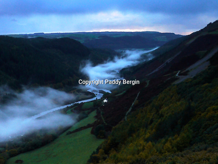 The Ystwyth Valley in early Autumn. This part of the river is about twelve miles inland from<br /> the seaside town of Aberystwyth.<br /> <br /> You can walk the length of the river on paths and tracks through beautiful countryside and sometimes you can see the mists floating along the valley and even get above them and look down to the solitary White House.<br /> <br /> Stock Photo by Paddy Bergin
