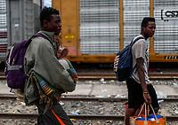 """Bryan Alberto Brega Herrera de 21 años y Exel Amilcar Sabio de 17, son originarios de Belice, ambos esperan llegar a los Estados Unidos en busca del sueño americano. <br /> <br /> <br /> La Caravana del Migrante conformada por un contingente de 600 personas su mayoría de origen centroamericano, arribaron a Hermosillo a bordo del tren conocido como """"La Bestia"""", provienen de la frontera Sur del País y con rumbo a la ciudad de Mexicali donde continuaran el viaje hasta Tijuana.<br /> La caravana tiene como objetivo solicitar <br /> asilo a Estados Unidos y algunos integrantes piensan solicitar una visa humanitaria en Mexico para laborar en los campos de Sonora y Baja California.<br /> (Photo: AP/Luis Gutierrez)"""