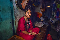 India, Maharashtra, Mumbai, Bombay. The red light district Falkland Road. One of the local women, Madhavi, watches over the children of the sex-workers in this room as their mothers are sleeping or working.               This is Tina, her niece that lives here.