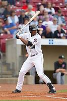 Cedar Rapids Kernels outfielder Adam Walker #38 bats during a game against the Kane County Cougars at Veterans Memorial Stadium on June 8, 2013 in Cedar Rapids, Iowa. (Brace Hemmelgarn/Four Seam Images)