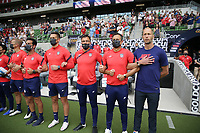 AUSTIN, TX - JULY 29: United States head coach Gregg Berhalter and members of his coaching staff during the playing of the national anthem during a game between Qatar and USMNT at Q2 Stadium on July 29, 2021 in Austin, Texas.