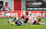Hamilton Accies v St Johnstone…25.09.16.. New Douglas Park   SPFL<br />Danny Swanson is sent flying by Dougie Imrie, Massimo Donati and Greg Docherty<br />Picture by Graeme Hart.<br />Copyright Perthshire Picture Agency<br />Tel: 01738 623350  Mobile: 07990 594431
