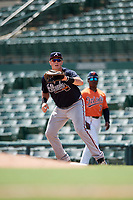 Atlanta Braves first baseman Austin Bush (59) waits for a throw during an Instructional League game against the Baltimore Orioles on September 25, 2017 at Ed Smith Stadium in Sarasota, Florida.  (Mike Janes/Four Seam Images)