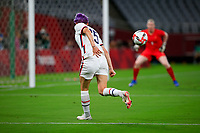 TOKYO, JAPAN - JULY 20: Megan Rapinoe #15 of the United States crosses a ball into the box during a game between Sweden and USWNT at Tokyo Stadium on July 20, 2021 in Tokyo, Japan.