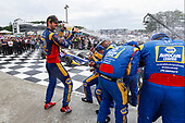 Alexander Rossi, Andretti Autosport Honda celebrates with champagne on the podium