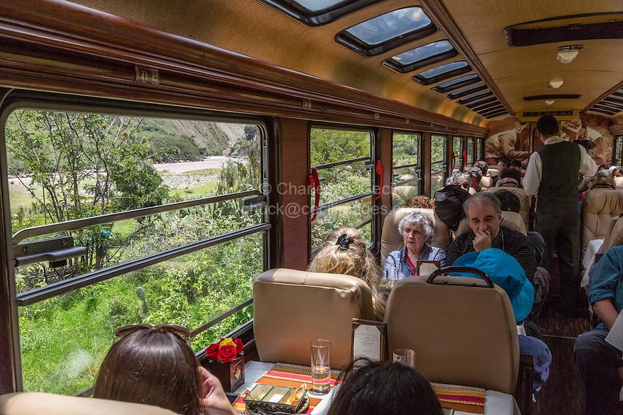 Peru, Machu Picchu.  Passengers on the Executive Class Inca Rail Train from Ollantaytambo to Machu Picchu.  Urubamba River on Left.