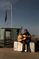 "Maral  with the Kabul based band ""White City"" playing guitar on the tajik/afghan border boat."