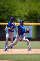 Tennessee Smokies third baseman Robel Garcia (4) throws to first base as shortstop Luis Vasquez (40) backs up the play during a Southern League game against the Jacksonville Jumbo Shrimp on April 29, 2019 at Baseball Grounds of Jacksonville in Jacksonville, Florida.  Tennessee defeated Jacksonville 4-1.  (Mike Janes/Four Seam Images)