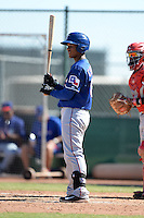 Texas Rangers designated hitter Andretty Cordero (86) during an Instructional League game against the Cincinnati Reds on October 3, 2014 at Surprise Stadium Training Complex in Surprise, Arizona.  (Mike Janes/Four Seam Images)