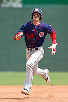 Bryce Harper #34 of the Hagerstown Suns hustles towards third base against the Rome Braves at State Mutual Stadium on May 2, 2011 in Rome, Georgia.   Photo by Brian Westerholt / Four Seam Images