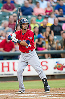 Oklahoma City RedHawks shortstop Jiovanni Mier (14) at bat during the Pacific Coast League baseball game against the Round Rock Express on August 1, 2014 at the Dell Diamond in Round Rock, Texas. The Express defeated the RedHawks 6-5. (Andrew Woolley/Four Seam Images)