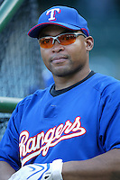 Marlon Byrd of the Texas Rangers during batting practice before a game against the Los Angeles Angels in a 2007 MLB season game at Angel Stadium in Anaheim, California. (Larry Goren/Four Seam Images)