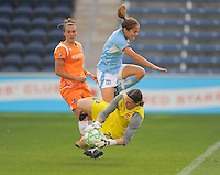 #6 Brittany Klein of the Chicago Red Stars tries to score against Sky Blue FC goalie #23 Jenni Bragam.  Sky Blue FC beat the Red Star 2-0.