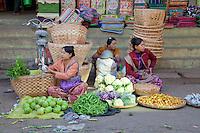 Myanmar, Burma, Mandalay.  Women Selling Vegetables in the Street.