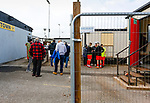 Fans wait at the entrance while Heanor players get some last minute instructions. Hucknall Town v Heanor Town, 17th October 2020, at the Watnall Road Ground, East Midlands Counties League. Photo by Paul Thompson.