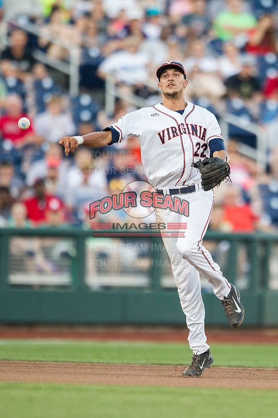 Virginia Cavaliers shortstop Daniel Pinero (22) makes a throw to first base against the Florida Gators in Game 13 of the NCAA College World Series on June 20, 2015 at TD Ameritrade Park in Omaha, Nebraska. The Cavaliers beat the Gators 5-4. (Andrew Woolley/Four Seam Images)