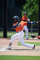 GCL Astros left fielder Hector Martinez (15) follows through on a swing during a game against the GCL Nationals on August 6, 2018 at FITTEAM Ballpark of the Palm Beaches in West Palm Beach, Florida.  GCL Astros defeated GCL Nationals 3-0.  (Mike Janes/Four Seam Images)