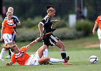 BOYDS, MARYLAND - July 22, 2012:  Lianne Sanderson (10) of DC United Women gets away from a sliding tackle by Kelsey Fenix (10) of the Charlotte Lady Eagles during the W League Eastern Conference Championship match at Maryland Soccerplex, in Boyds, Maryland on July 22. DC United Women won 3-0.