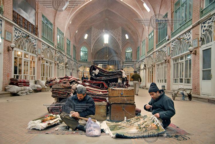 Two men weaving carpets in a karavansaray in the city's old bazaar.
