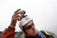 Neil Amunson adjust his camera before jumping. World BASE Race held in Innfjorden, Norway, where BASE jumpers in wingsuits compete in flying down the mountain. The winner is called the World's Fastest Flying Human Being..©Fredrik Naumann/Felix Features.