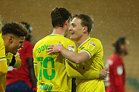 6th April 2021; Carrow Road, Norwich, Norfolk, England, English Football League Championship Football, Norwich versus Huddersfield Town; Kieran Dowell of Norwich City celebrates his goal with Oliver Skipp for 5-0 in the 42nd minute