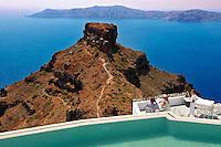 Hotel terrace overlooking the volcanic plug  of Imerovigli, Santorini, Greece.