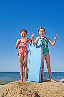Girlfriends posing at the beach.