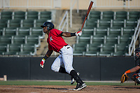 Micker Adolfo (27) of the Kannapolis Intimidators follows through on his swing against the Delmarva Shorebirds at Kannapolis Intimidators Stadium on July 2, 2017 in Kannapolis, North Carolina.  The Shorebirds defeated the Intimidators 5-4.  (Brian Westerholt/Four Seam Images)