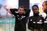Wednesday 07 August 2013<br /> Pictured: Leon Britton (L) at Cardiff Airport.<br /> Re: Swansea City FC travelling to Sweden for their Europa League 3rd Qualifying Round, Second Leg game against Malmo.