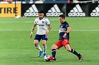FOXBOROUGH, MA - APRIL 24: Matt Polster #8 of New England Revolution passes the ball as Junior Moreno #5 of D.C. United closes during a game between D.C. United and New England Revolution at Gillette Stadium on April 24, 2021 in Foxborough, Massachusetts.