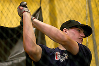 Brandon Nimmo takes a swing at a pitch inside a batting cage that sits in the family barn on Tuesday, June 21, 2011, in Cheyenne, Wyo. (Photo by James Brosher)