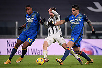 Marvin Zeegelaar of Udinese Calcio , Aaron Ramsey of Juventus FC and Kevin Bonifazi of Udinese Calcio during the Serie A football match between Juventus FC and Udinese Calcio at Juventus stadium in Torino  (Italy), January, 3rd 2021.  Photo Federico Tardito / Insidefoto