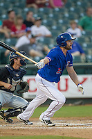 Round Rock Express outfielder Brad Snyder (25) follows through on his swing during the Pacific Coast League baseball game against the Omaha Storm Chasers on June 1, 2014 at the Dell Diamond in Round Rock, Texas. The Express defeated the Storm Chasers 11-4. (Andrew Woolley/Four Seam Images)