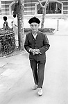 China, Shanghai. An elderly man sporting a beret in the former French Park, now Fuxing Park.  He is wearing the so-called Sun Yat Sen suit, a single-breasted jacket with soft collar and four large pockets, adopted as the modern Chinese male costume after the 1911 Revolution in place of the long gown.  Before 1911 the Chinese male costume had no pockets...