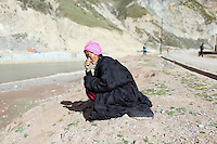 A Tibetan woman in Zaduo, in the far interior of the Tibetan Plateau, in western China. Relocation communities been created to house nomadic herders moved from the highland grasslands. The nomads have been blamed for contributing to the deterioration of the grasslands, so have been moved, sometimes forcibly, into newly built towns that can be found across the plateau.