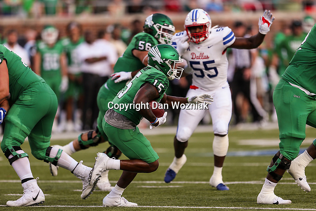 North Texas Mean Green running back Tre Siggers (15) in action during the game between the UNT Mean Green and the SMU Mustangs at the Gerald J. Ford Stadium in Fort Worth, Texas.