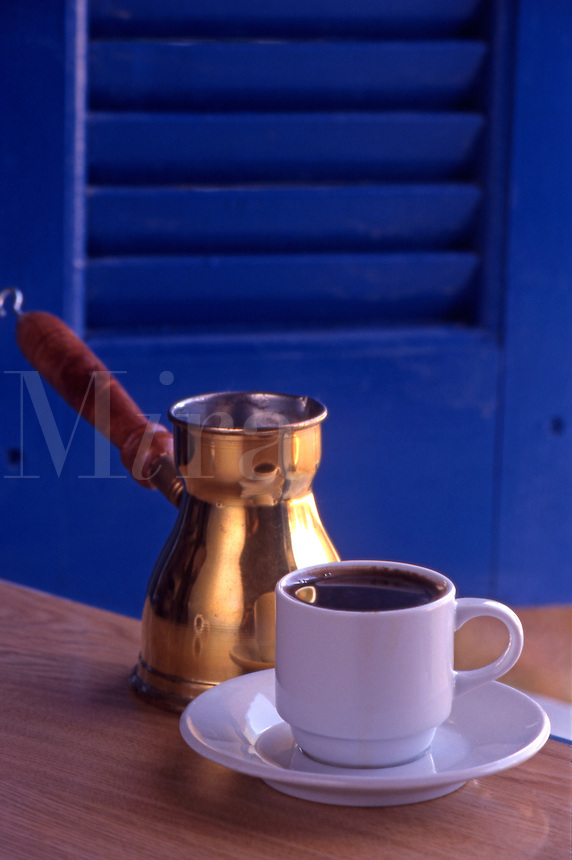 A cup of strong greek coffee, plus copper coffee pot. .Crete. Greece.