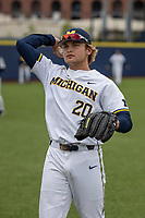 Michigan Wolverines pitcher Willie Weiss (20) warms up before the NCAA baseball game against the Michigan State Spartans on May 7, 2019 at Ray Fisher Stadium in Ann Arbor, Michigan. Michigan defeated Michigan State 7-0. (Andrew Woolley/Four Seam Images)