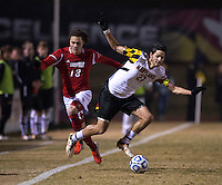 John Stertzer (27) of Maryland is fouled by Brock Granger (13) of Louisville during the game at Ludwig Field in College Park, MD.  Maryland defeated Louisville, 3-1.