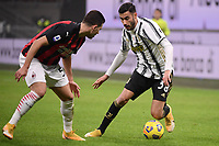 Diogo Dalot of AC Milan and Gianluca Frabotta of Juventus FC compete for the ball during the Serie A football match between AC Milan and Juventus FC at San Siro Stadium in Milano  (Italy), January 6th, 2021. Photo Federico Tardito / Insidefoto