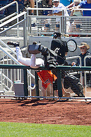 Virginia Cavaliers first baseman Pavin Smith (10) falls over a rail to catch a foul ball against the Florida Gators in Game 11 of the NCAA College World Series on June 19, 2015 at TD Ameritrade Park in Omaha, Nebraska. The Gators defeated Virginia 10-5. (Andrew Woolley/Four Seam Images)