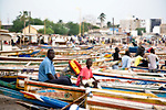 Colorfully painted fishing boats line the beach at this fish market in Dakar, Senegal.