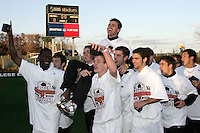 Maryland players carry head coach Sasho Cirovski off the field as the SAS Stadium scoreboard tells the story of the victory. The University of Maryland defeated the University of New Mexico 1-0 in the NCAA Final at SAS Stadium in Cary, North Carolina, Sunday, December 11, 2005.