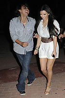 MIAMI BEACH, FL -  MARCH 26:  Kim Kardashian single and having fun in Miami Beach.  Kim Kardashian looking happy and single. Kim and sister Kourtney Kardashian were joined by publicist not-so-extraordinaire Jonathan Cheban at dinner . On March 26, 2010 in Miami Beach, Florida<br /> <br /> <br /> People:  Kim Kardashian_Kourtney Kardashian_Jonathan Cheban
