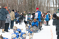 Aliy Zirkle and team run past spectators on the bike/ski trail near University Lake with an Iditarider in the basket and a handler during the Anchorage, Alaska ceremonial start on Saturday, March 7 during the 2020 Iditarod race. Photo © 2020 by Ed Bennett/Bennett Images LLC