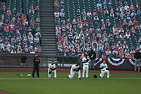 SAN FRANCISCO, CA - JULY 29:  Manager Gabe Kapler #19, Pablo Sandoval #48, Donovan Solano #7 and Mike Yastrzemski #5 of the San Francisco Giants kneel and stand during the National Anthem before the game against the San Diego Padres at Oracle Park on Wednesday, July 29, 2020 in San Francisco, California. (Photo by Brad Mangin)