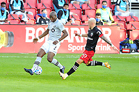 WASHINGTON, DC - NOVEMBER 8: Rod Fanni #7 of Montreal Impact Kevin battles for the ball with Erick Sorga #50 of D.C. United during a game between Montreal Impact and D.C. United at Audi Field on November 8, 2020 in Washington, DC.