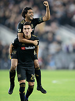 LOS ANGELES, CA - OCTOBER 29: Carlos Vela #10 and Eduard Atuesta #20 of the Los Angeles FC celebrate an LAFC Eduard Atuesta goal during a game between Seattle Sounders FC and Los Angeles FC at Banc of California Stadium on October 29, 2019 in Los Angeles, California.