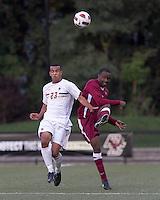 Boston College defender Stefan Carter (23) and Harvard University defender Baba Omosegbon (6) battle for the ball. Boston College defeated Harvard University, 2-0, at Newton Campus Field, October 11, 2011.