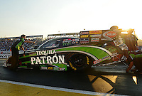 Oct. 5, 2012; Mohnton, PA, USA: NHRA Del Worsham, crew chief (left) and crew members for funny car driver Alexis DeJoria during qualifying for the Auto Plus Nationals at Maple Grove Raceway. Mandatory Credit: Mark J. Rebilas-